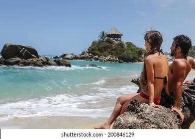 Couple looking at the Sea, Tayrona National Park, Tropical Colombia. South America
