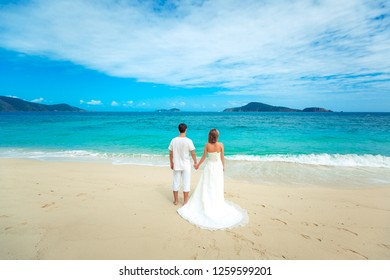 Couple looking at the sea in wedding clothing. Back view. Phuket. Thailand. Trip to warm destination. sea wedding