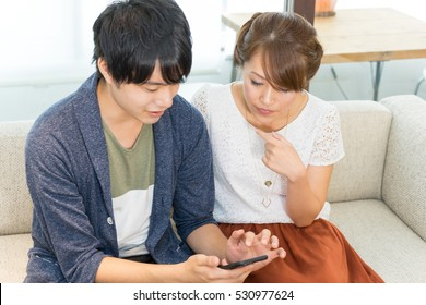 Couple looking at smartphones