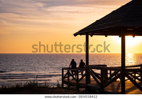 couple-looking-sunset-on-beach-600w-1814