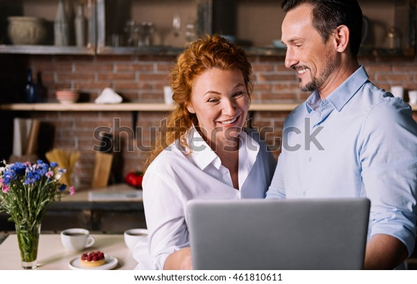 Couple looking at tablet and talking