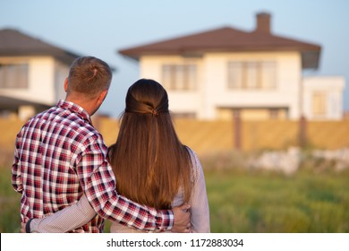 Couple looking at their house