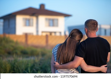 Couple looking at they's house