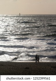 A couple looking at the waves in Westerland (Sylt)