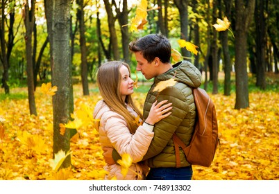 Couple in love in the autumn forest. Nature background