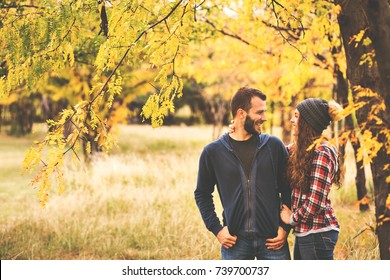Couple in love in autumn leaves