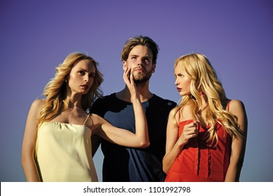 Couple in love. Beauty and summer fashion. Love triangle and romance. Man with beard with twins, relations. Family trust, polygamy, betrayal, swinger. Twins women with macho on blue sky background