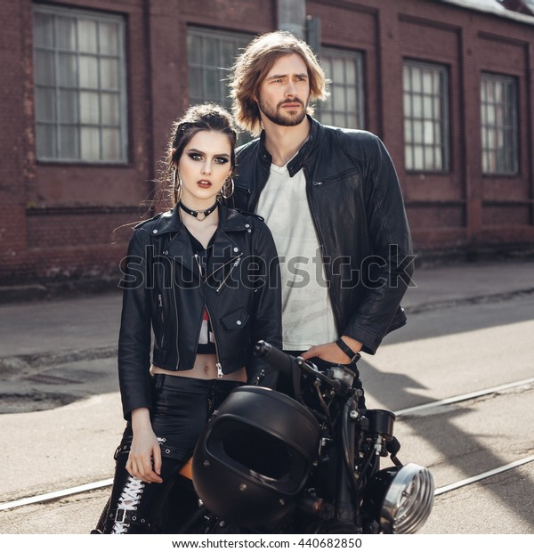 Couple in love. Bikers and vintage custom motorcycle. Outdoor lifestyle portrait