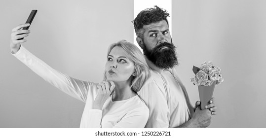 Couple in love bouquet dating celebrate anniversary relations. Sharing happy selfie. Woman capturing happy moment boyfriend bring bouquet flowers. Capturing moment to memorize. Taking selfie photo.