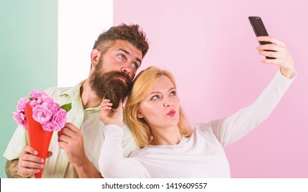 Couple in love bouquet dating celebrate anniversary relations. Sharing happy selfie. Capturing moment to memorize. Woman capturing happy moment boyfriend bring bouquet flowers. Taking selfie photo.