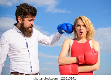 Couple in love boxing gloves sky background. Man punch girl boxing glove. She did not expect be attacked. Prepare for sudden attack. Woman undergoes violence. Stop violence. Learn to resist punch.