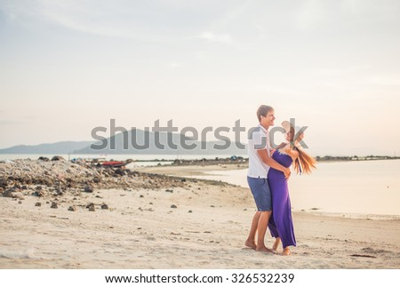 a616fd21b6d2 Couple in love, boy shorts and the girl in a dress and hat resting and