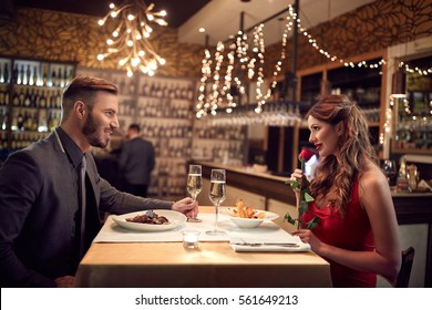 Couple in love celebrate Valentine's Day with romantic dinner