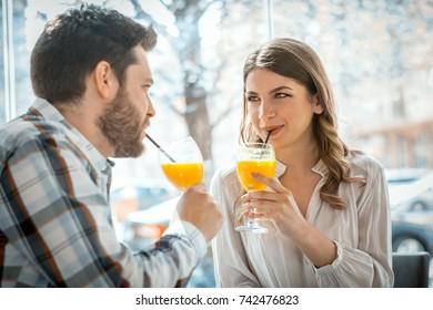 Couple in love driking juice