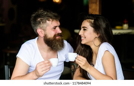 Couple in love drink black espresso coffee in cafe. Couple enjoy hot espresso. Romantic date in cafe. Drinking black coffee improves your mood and thus makes you happy. Pleasant coffee break.