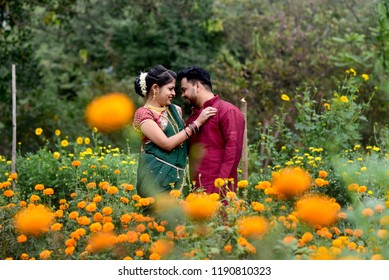 couple in love enjoy a moment of happiness in marigold flower garden with field flowers on nature, Maharashtrian Couple, Indian