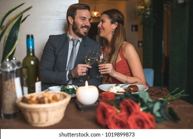 Couple in love enjoying delicious food in luxury restaurant. Valentines day. Romantic evening.