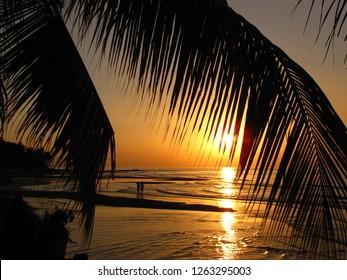 Couple in love enjoying the sunset at Lovina beach, Bali, Indonesia