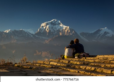 Couple in love enjoying view of Dhaulagiri from Poon Hill. Himalaya Mountains, Nepal.