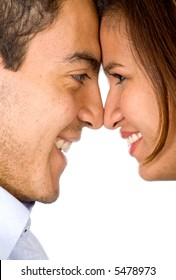 a couple in love face to face smiling - isolated over a white background