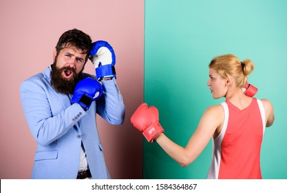 Couple in love fighting. problems in relationship. sport. bearded man hipster fighting with woman. family couple boxing gloves. knockout punching. who is right. win the fight. Strength and power.