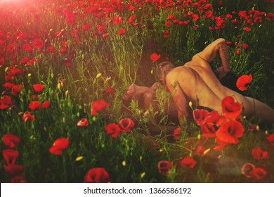 Couple in love. Flowers background. Man and woman nature. Guy. Nude couple. Fashion photo. Model. Summer time. Beauty photo. Erotica. Erotic. Passionate concept.