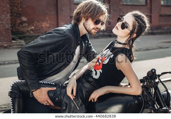 Couple in love. Guy and girl on vintage custom motorcycle. Outdoor lifestyle portrait