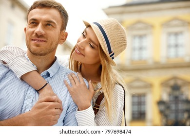 Couple In Love. Happy Romantic People On Street. Portrait Of Beautiful Smiling Young Man And Cute Woman Having Fun, Hugging And Enjoying Each Other Outdoors. Couple Relatioships. High Quality Image.