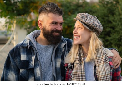 Couple in love. Happy young couple in love enjoying their romantic moment. Beautiful couple in love walking outdoors. Carefree time together. Fall autumn season