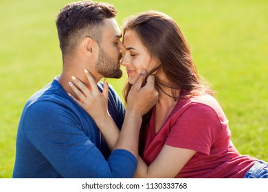 couple in love have fun in the park and drink smoothies and eating fruit at a picnic