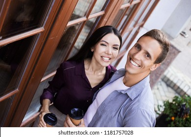 Couple in love having fun in the park. Man giving piggyback to woman. Young adults girlfriend and boyfriend hugging happy. Cozy mood, romantic travaling togetherness concept