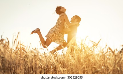 couple in love having fun in a wheat field