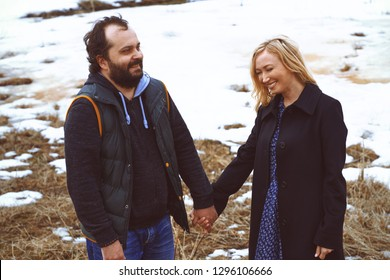 Couple in love having fun and in the winter landscape. Man and woman in love
