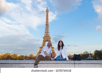 Couple in love holding hands at the Eiffel Tower in Paris, Franc