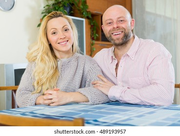 Couple in love at home in the living room