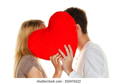 couple in love kissing behind a heart. love is beautiful. secret love