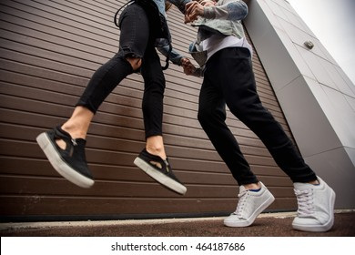 Couple. Couple in love looking at each other and smiling. Couple in denim jeans walking outdoors. Lifestyle concept, love story of young couple on casual jeans denim. Happy couple, jeans, denim.