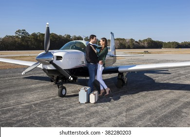 Couple in love with luggage and private plane