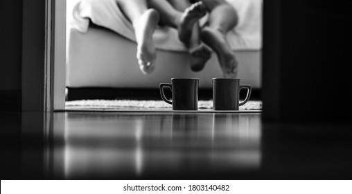 Couple in love lying in bed in hotel. Coffee time. Good morning. Couple in love.