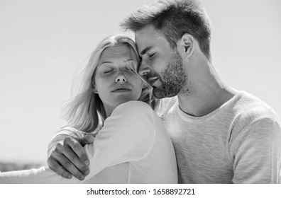 Couple in love. Man and woman sunny day outdoors. True love. Tenderness concept. Enjoy every moment. Peaceful romantic people. Enjoyment. Summer romance. Family love. Love story. Romantic relations.