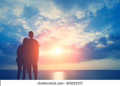 Couple in love on the background of the sea and sky with clouds