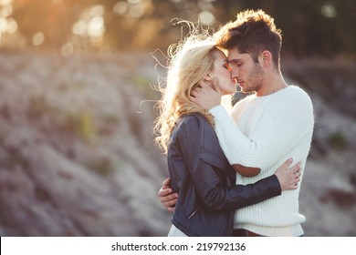 couple in love on the beach in autumn