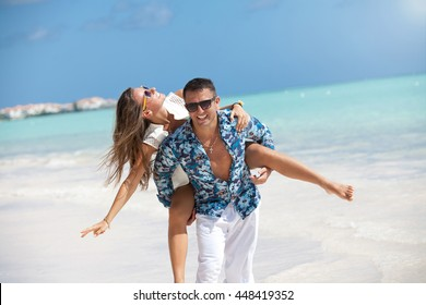 Couple in love on exotic beach summer luxury vacations. Caribbean paradise.