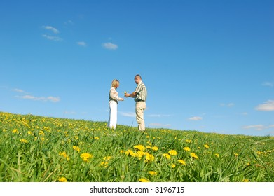 Couple in love on spring meadow