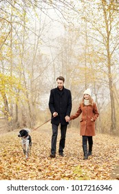 Couple in love on Valentine's day walking in the Park with the dog. The love and tenderness between a man and a woman. Valentine's day is a holiday of all lovers