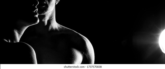 Couple in love posing on a white background with beautiful backlight. Portraits side view in silhouette. A silhouette photo of a guy in front of a girl and a girl on against a guy. Love