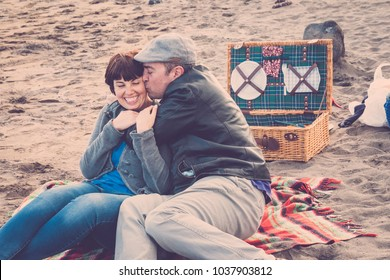 couple in love relationship do an outdoor picnic at the beach in vacation. alternative lifestyle concept for leisure. summer time in holiday
