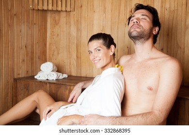 Couple in love relaxing in the sauna