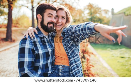 Couple in love. Romantic couple enjoying in moments of happiness in the autumn park. Love and tenderness, dating, romance. Lifestyle concept