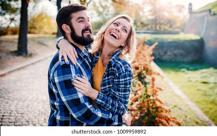 Couple in love. Romantic couple enyojing in moments of happiness in the park. Love and tenderness, dating, romance. Lifestyle concept